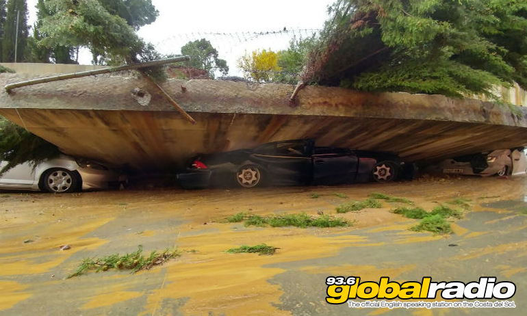 Cars crushed under a collapsed bridge near La Linea